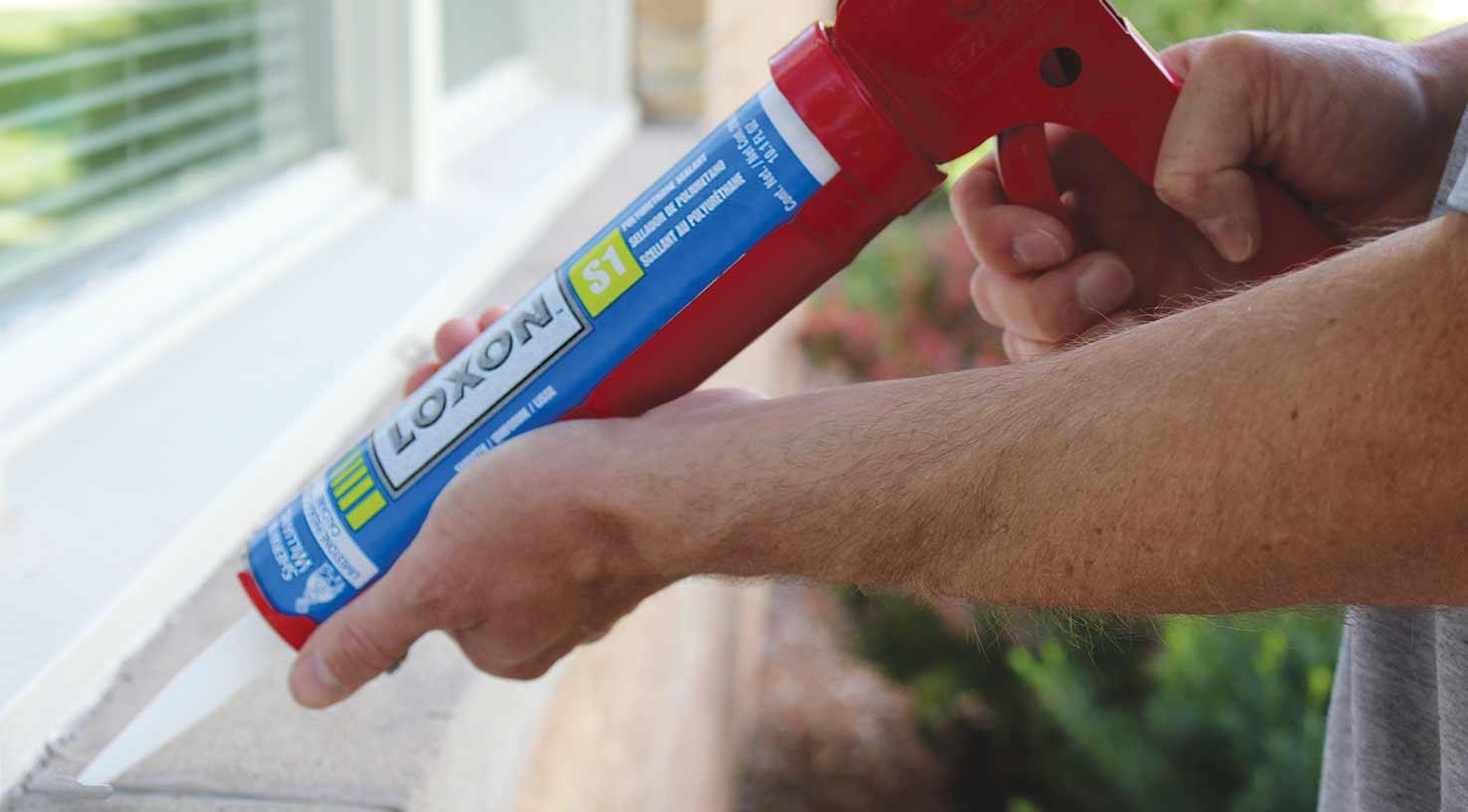 Loxon sealant being applied to exterior masonry windowframe