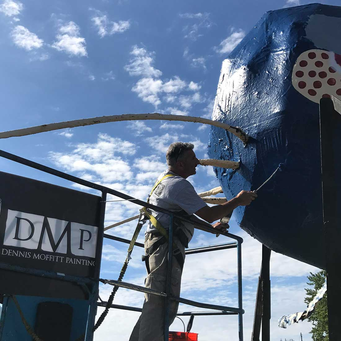 Dennis Moffitt Painting puts the finishing touches on the Big Blue Bug