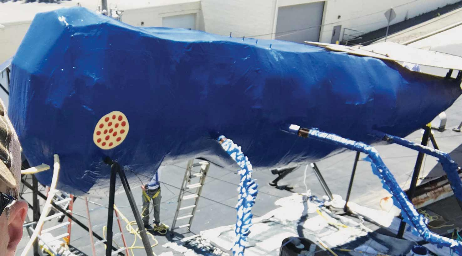 the newly restored Big Blue Bug, 58 foot long mascot of a pest control company in Providence, Rhode Island since 1980