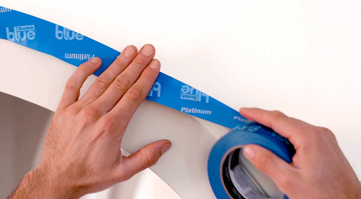 Painters tape being applied to a curved entry