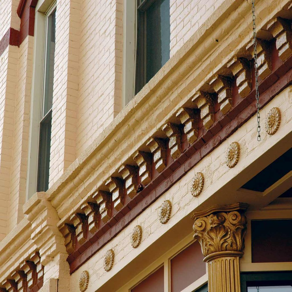 Painted exterior masonry details on the 1881 Frederick Rehfuss Building