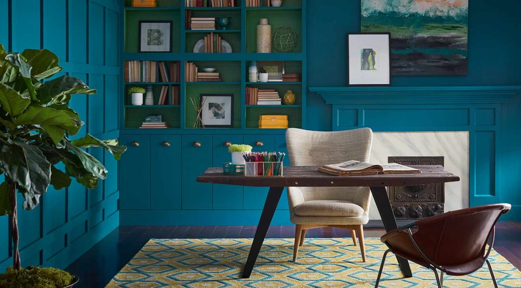 Color of the Year Oceanside (SW6496) enlivens the interior walls of a study
